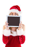 Pretty santa girl holding tablet
