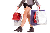 Lower half of woman with shopping bags