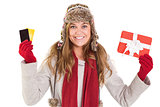 Happy blonde in winter clothes holding gifts