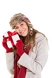 Happy blonde in winter clothes holding gift