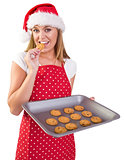 Festive homemaker showing hot cookies