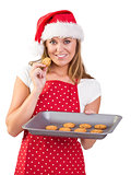 Festive homemaker showing hot cookies