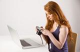 Pretty redhead working on laptop