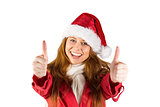 Festive redhead showing thumbs up