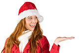 Festive redhead presenting with hand