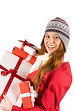 Pretty redhead in warm clothing holding gifts