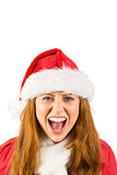 Festive redhead shouting at camera