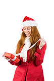 Festive redhead holding pile of gifts