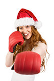 Festive redhead punching with boxing gloves
