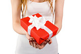 Woman holding red and white gift