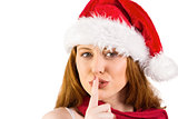Festive redhead making quiet sign