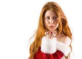 Festive redhead blowing a kiss