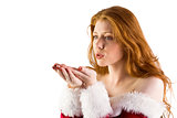Festive redhead blowing over hands