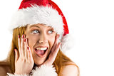 Festive redhead with hands on face