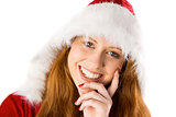 Festive redhead with hand on chin
