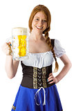 Oktoberfest girl smiling at camera holding beer
