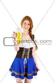 Oktoberfest girl smiling at camera holding beer