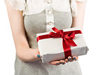 Woman offering a wrapped gift