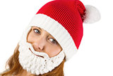 Pretty redhead in santa hat and beard