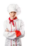 Pretty chef standing with arms crossed