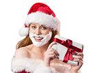 Festive redhead in foam beard holding gift