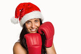 Woman wearing red boxing gloves