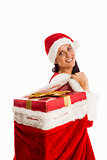 Woman smiling with christmas presents