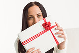 Woman holding a large present