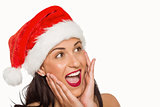 Surprised woman wearing santa hat