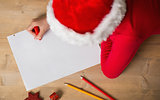 Little girl writing letter to santa at christmas