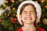 Festive little girl scrunching up her face