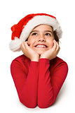 Festive little girl smiling and looking up