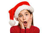 Festive little girl looking surprised