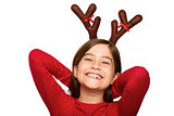 Festive little girl wearing antlers