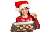 Festive little girl offering cookies