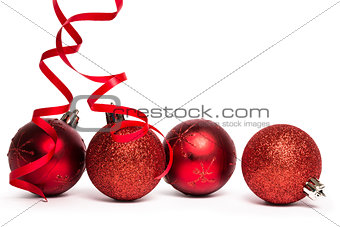 Four red christmas ball decorations