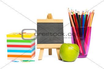 Black chalkboard with school supplies