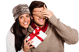 Young woman giving gift to boyfriend