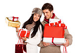 Young couple with many christmas presents