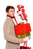 Young man with many christmas presents