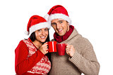 Young festive couple holding mugs