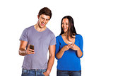 Young couple sending a text