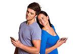 Young couple sending a text