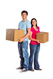Young couple holding moving boxes
