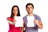 Couple showing broken piece of paper