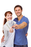 Couple holding fan of cash