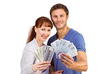 Couple holding fans of cash