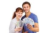 Couple holding fans of cash