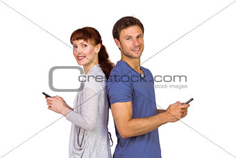 Couple both sending text messages