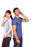 Couple both making phone calls